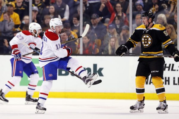 Montreal Canadiens' Brendan Gallagher celebrates his goal in front of Boston Bruins' Tim Schaller during the second period of an NHL hockey game in Boston on Saturday, Oct. 22, 2016. (AP Photo/Winslow Townson)
